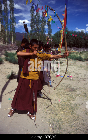 monk in archery contest Shey Ladakh Indian Himalaya - Stock Photo