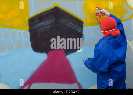 A girl taking part in a graffiti art workshop in a primary school in Tower Hamlets, East London. - Stock Photo