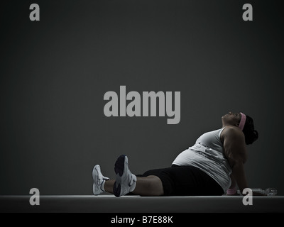 Overweight woman in sports clothing - Stock Photo