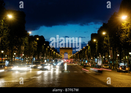 Famous Paris street - the Champs Elysees, with the Arc de Triomphe at night, Paris, France, Europe - Stock Photo