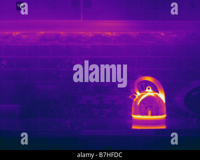 Infrared image of kettle in kitchen showing heat loss - Stock Photo