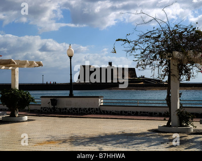 The sea front at Arrecife in the Canary Island of Lanzarote with the castle Castillo de san Gabriel now an Archaeological - Stock Photo