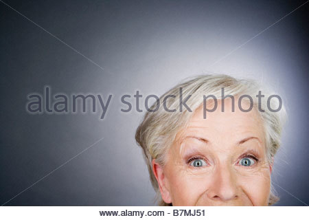 A senior woman looking surprised - Stock Photo