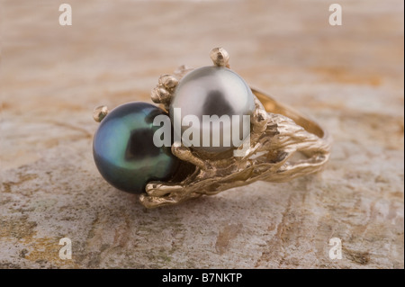 Pearl ring, doublet - silver/white pearl, black pearl, in gold setting - Stock Photo