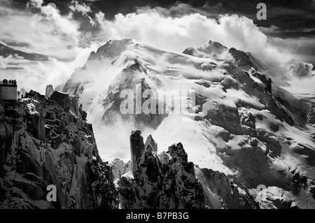 Mont-Blanc du Tacul, Arete des Cosmiques and the observation platform of the Aiguille du Midi cablecar, Chamonix, - Stock Photo