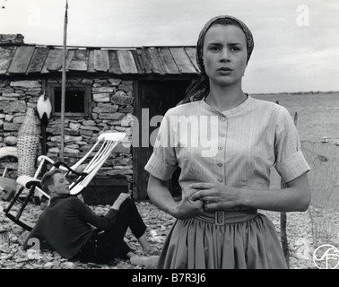 Sasom I En Spegel Year: 1961 Director: Ingmar Bergman Harriet Andersson, Lars Passgård - Stock Photo