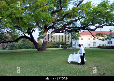 High tea being prepared on the lawn at Victoria Falls Hotel - Stock Photo