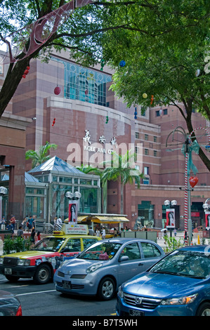 Ngee Ann City shopping mall Singapore Orchard road people modern fashion luxury shop store shops stores - Stock Photo