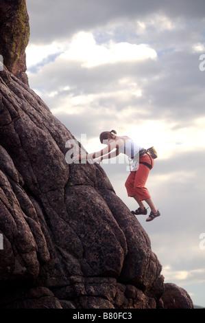 Female rock climber, Colorado Rocky Mountains - Stock Photo