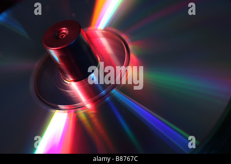 stack of CD's on a spindle lit with red and blue studio lighting - Stock Photo