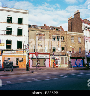 A row of derelict shops at the junction of Redchurch Street and Commercial Street near Brick Lane, East London UK - Stock Photo