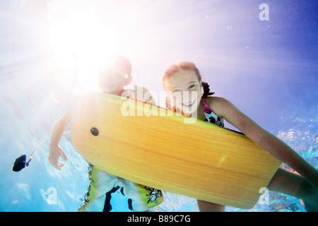 kids swimming underwater - Stock Photo