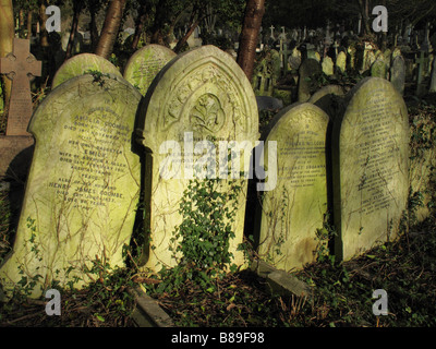 Old headstones in Highgate cemetery, London - Stock Photo