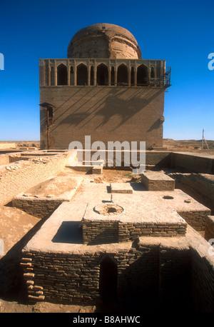 Merv (Mary) ruins, ancient silk road city, including the Mausoleum of Sultan Sanjar at rear - Stock Photo