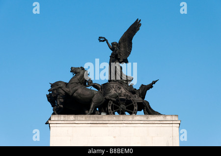 The Angel of Peace Descending on the Chariot of War by Adrian Jones atop the Wellington or Constitution Arch London - Stock Photo