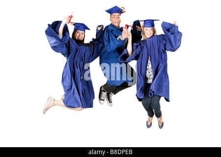 High school graduates jumping - Stock Photo
