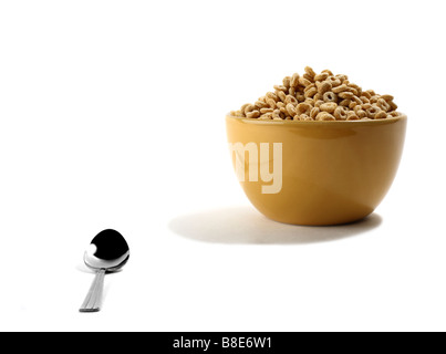 Cereal in Bowl with Spoon - Stock Photo