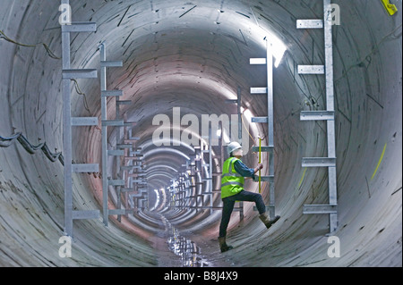 Engineer examines newly installed brackets which will carry the permanent equipment to be installed in this power - Stock Photo