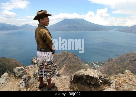Maya Indian in traditional costume from Santiago de Atitlan overlooks Lake Atitlan, Guatemala, Atitlansee, Santiago - Stock Photo