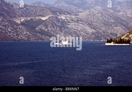 Montenegro, Bay of Kotor. Two islets off the coast of Perast. Our Lady of the Rocks and island Saint George. - Stock Photo