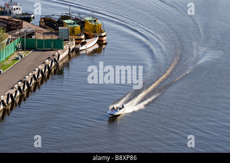 high speed motor boat with wave trail on the water - Stock Photo