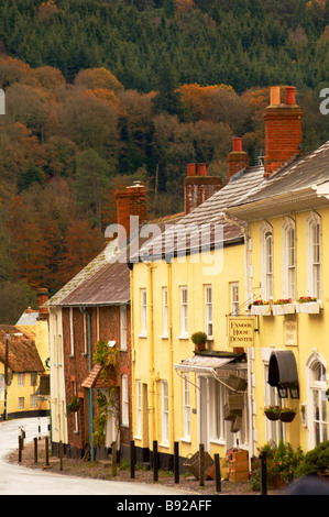 Row of pubs hotels and thatched traditional cottages on Dunster High Street Exmoor Somerset UK - Stock Photo