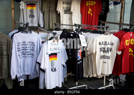 Various cold war and tourist items on sale near Checkpoint Charlie in Berlin Germany - Stock Photo