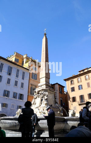 Fountain on the Piazza della Rotonda and the Roman Pantheon in Rome Italy - Stock Photo