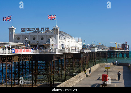 ENGLAND East Sussex Brighton Brighton Pier on a sunny windy day with a groyne alongside it. - Stock Photo
