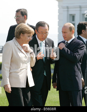 Left to right German Chancellor Angela Merkel UN Secretary General Ban Ki moon and Russian President Vladimir Putin - Stock Photo