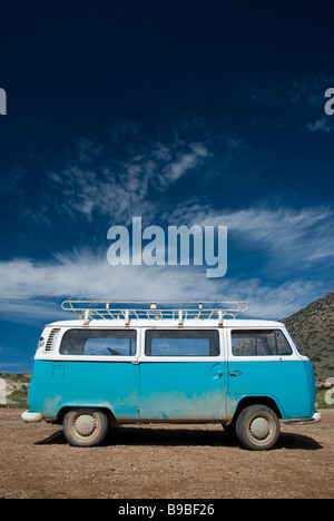 A Volkswagen Kombi van parked at Boilers surf break on Cap Rihr in Morocco. - Stock Photo