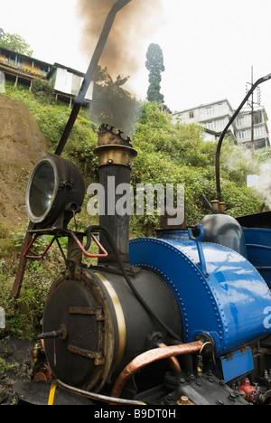 Smoke emitting from a steam engine, Darjeeling Himalayan Railway, Darjeeling, West Bengal, India - Stock Photo