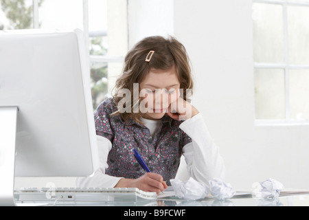 Close-up of girl studying at table - Stock Photo