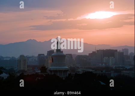 China, Beijing, Beihai Park. Sunset over the White Dagoba temple - Stock Photo