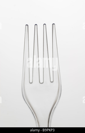 Clear plastic fork against a white background - Stock Photo