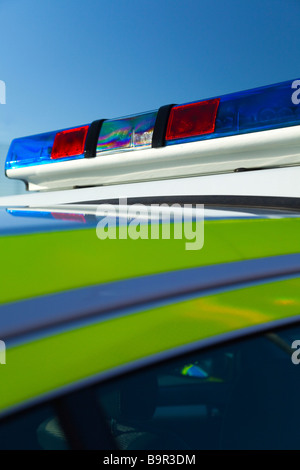 Red and Blue police lights on a police car in summer under a clear blue sky, Cheshire, England, UK - Stock Photo