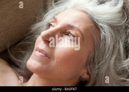 senior woman looking pensive / daydreaming - Stock Photo