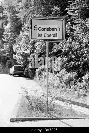 Eighties, black and white photo, ecology, nuclear energy, city name on a place-name sign is pasted over by the slogan - Stock Photo