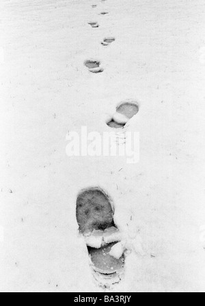 Seventies, black and white photo, winter, weather, snow, footprints in the snow - Stock Photo