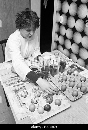Seventies, black and white photo, Easter, symbolic, young woman colouring Easter eggs, aged 20 to 25 years, Monika - Stock Photo