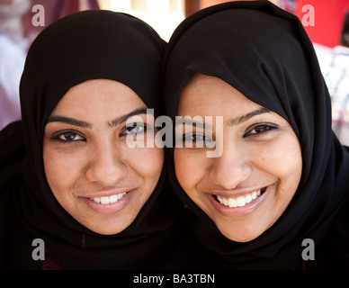 two Qatari students in national costume at International Students' Day, American University in Cairo, Egypt - Stock Photo