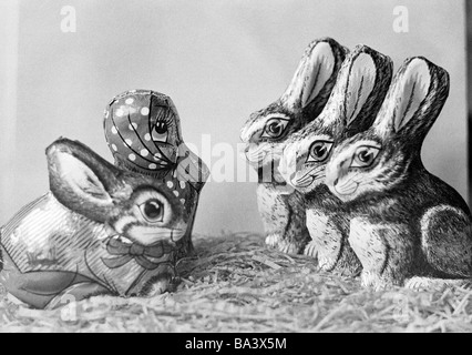 Seventies, black and white photo, Easter, symbolic, sweets, Easter bunnies and a duck from chocolade - Stock Photo