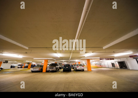 Underground parking garage; multi-story car park; parking structure with cars in Washington DC. - Stock Photo