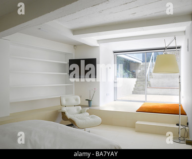 Bedroom with view to roof access in Loft Apartment, Islington, London, UK. - Stock Photo