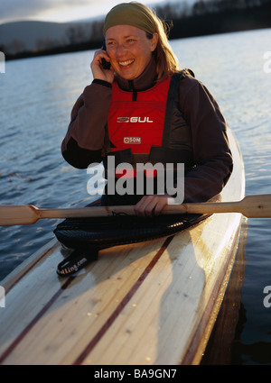 A woman in a kayak Lapland Sweden - Stock Photo