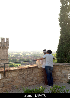 A young couple enjoys a romantic moment together in the Italian countryside. - Stock Photo