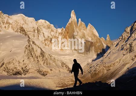 Silhouette of tourist Sunrise on the Cerro Torre massif Glacier Glaciares National Park Andes Santa Cruz Province - Stock Photo