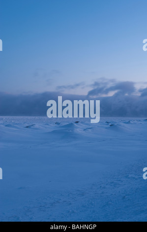 CLOUDS ROLL OVER THE HORIZON OF LAKE SUPERIOR IN EARLY MORNING LIGHT - Stock Photo