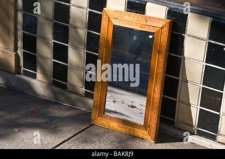 mirror on sidewalk - Stock Photo