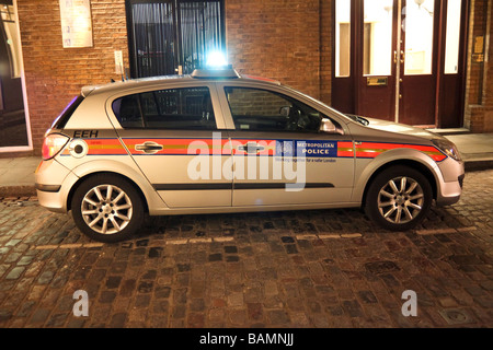 police car with emergency blue lights flashing, London, England - Stock Photo